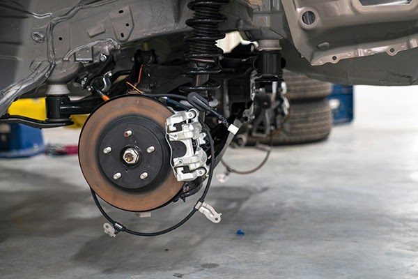 What is a car suspension system